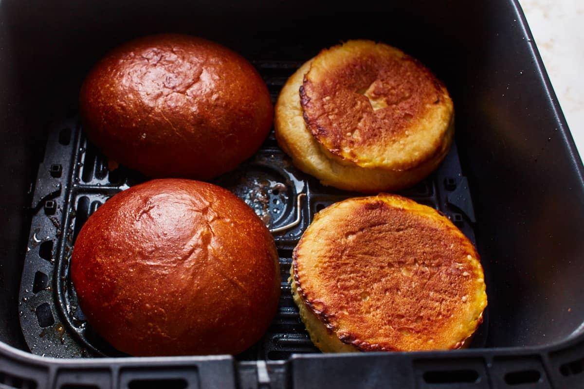 Burger buns in an air fryer basket