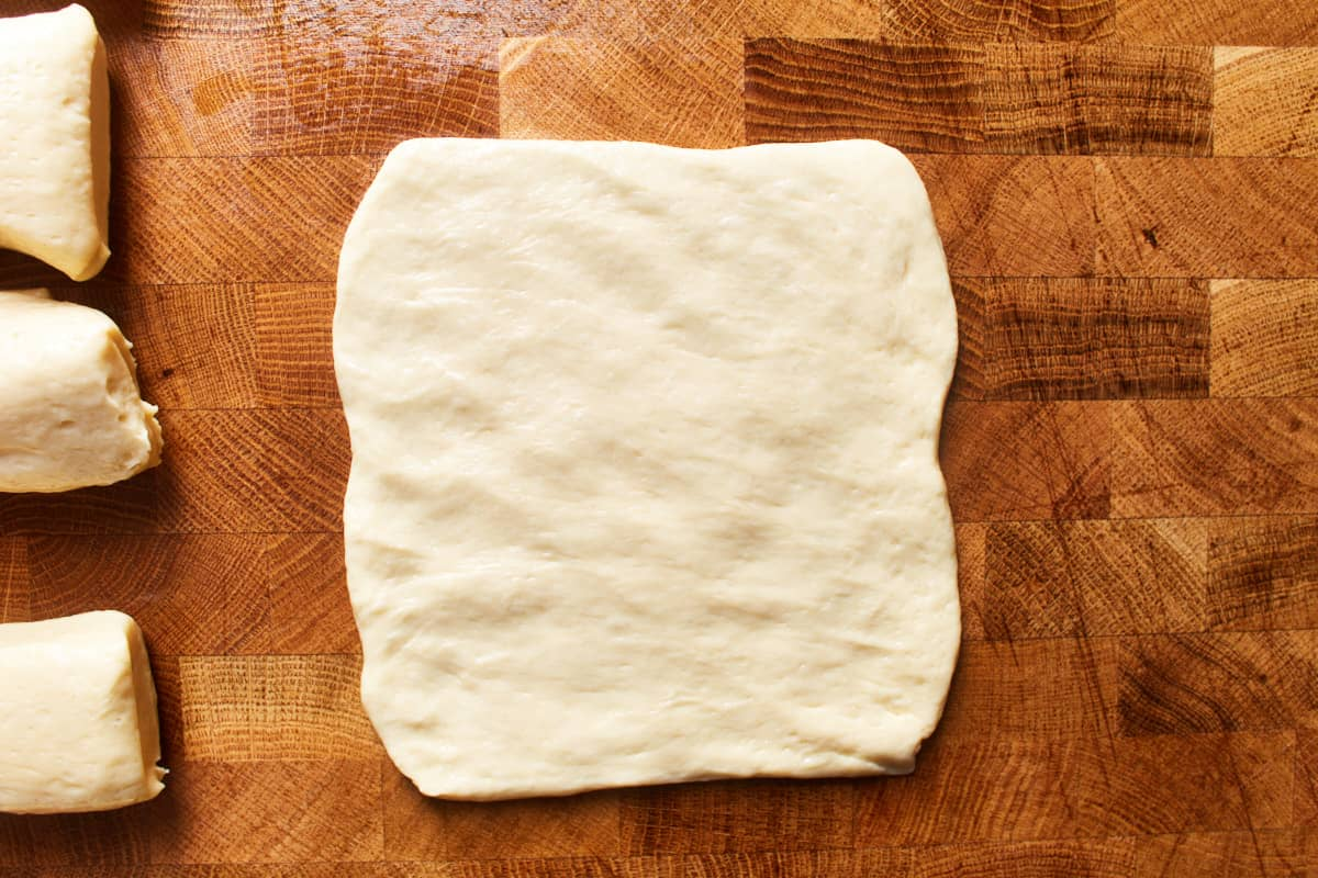 Flattened piece of dough on a work surface