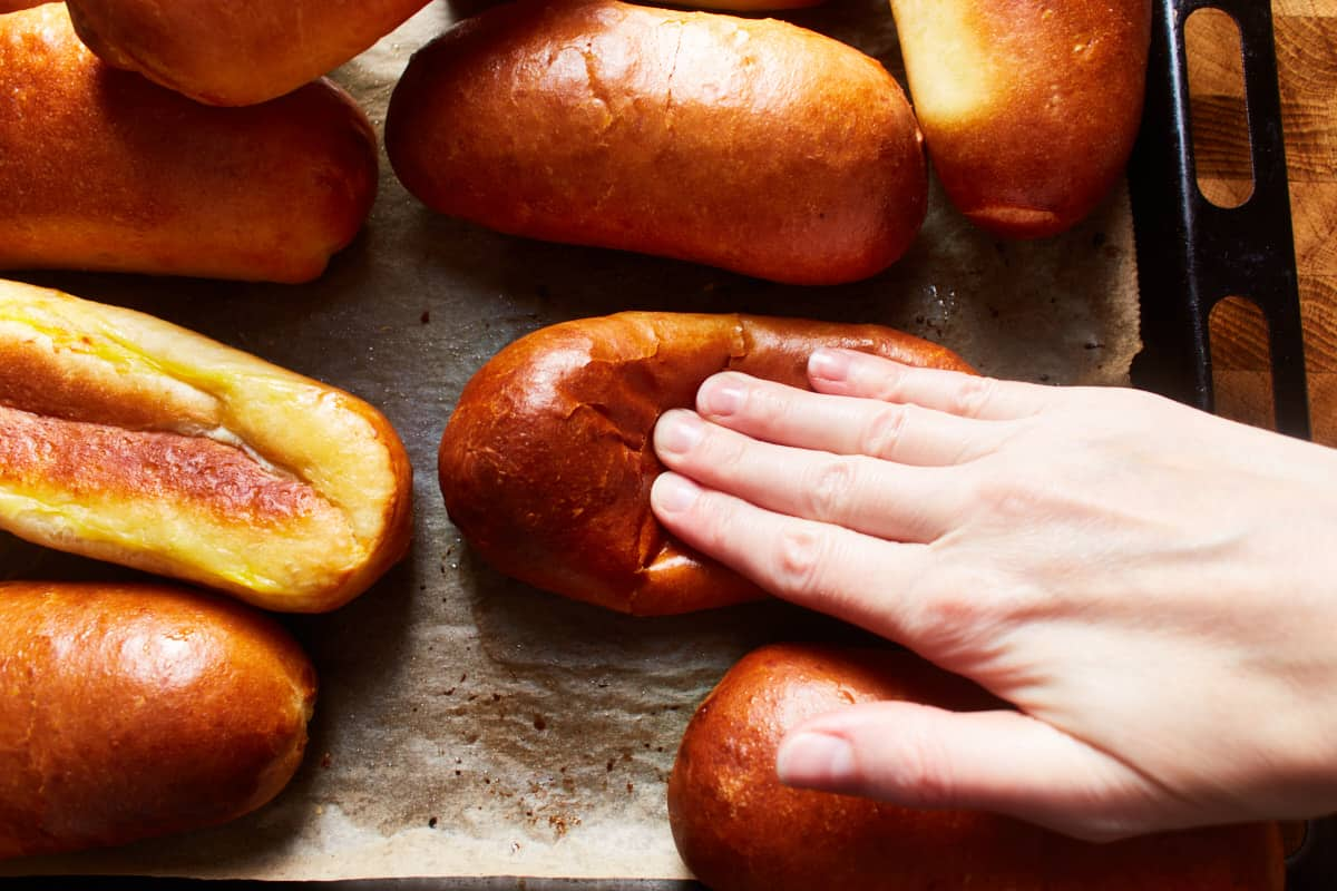 Pressing down on a bun with fingers
