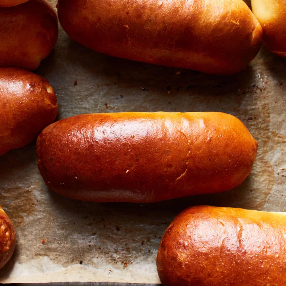 Hot dog buns on a baking sheet