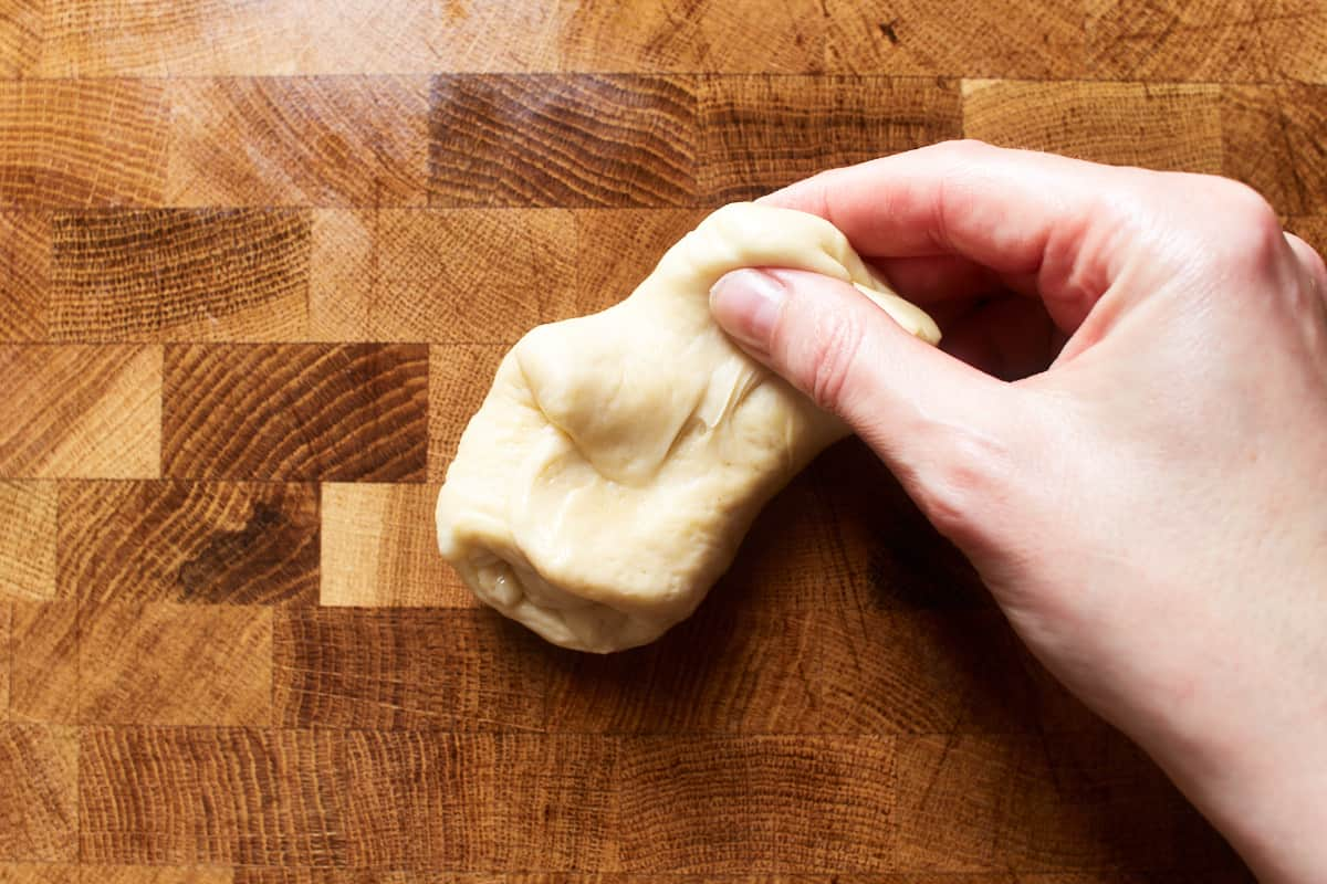 Stretching up a piece of dough