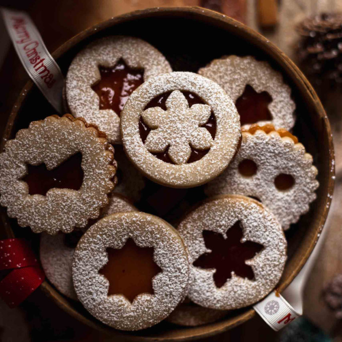 Box of sugar dusted Linzer Cookies