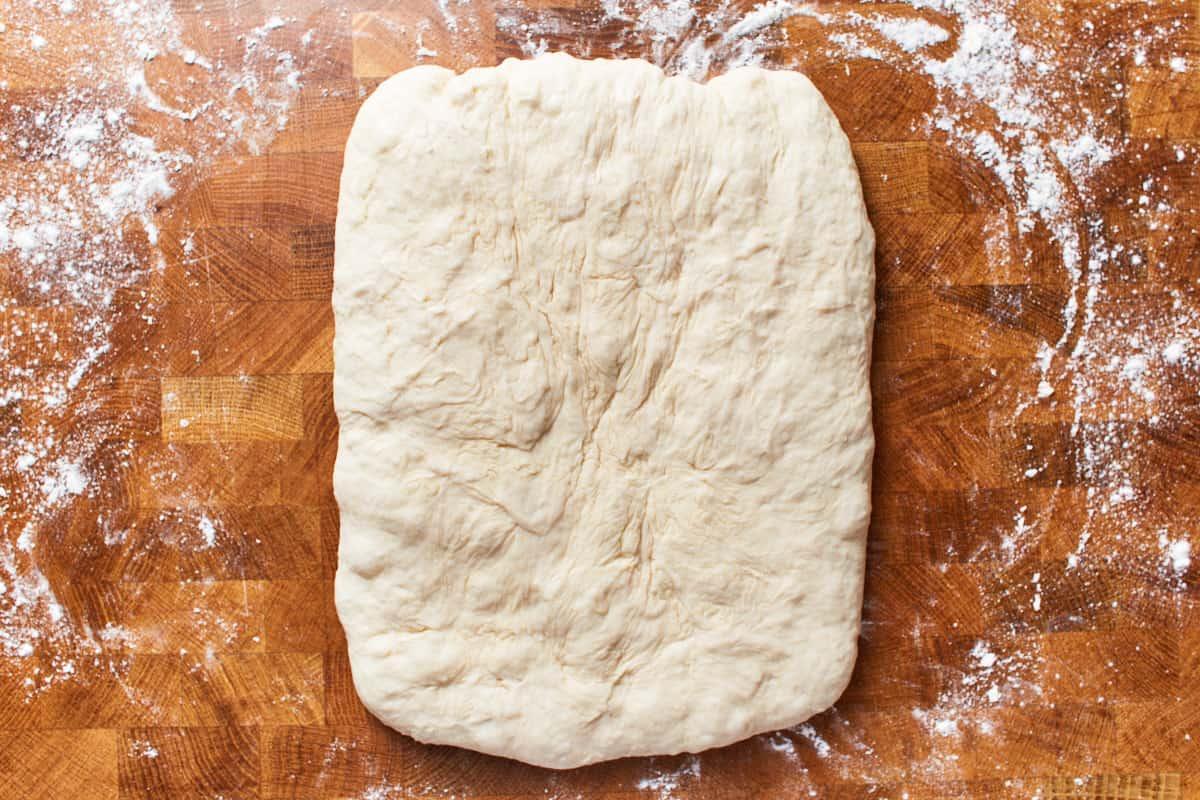Deflated dough shaped into a rectangle