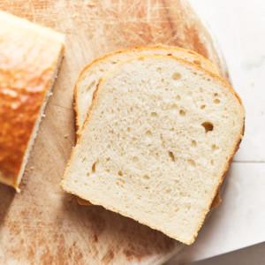Sliced sourdough sandwich on a cutting board