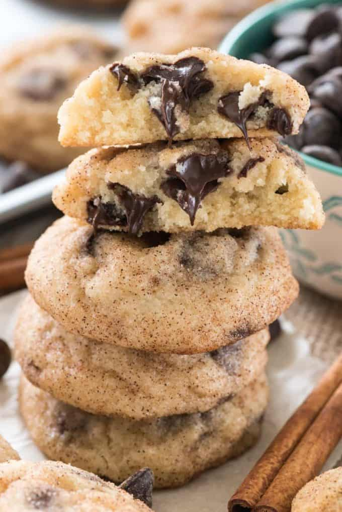 A stack of cookies with one broken in half on top