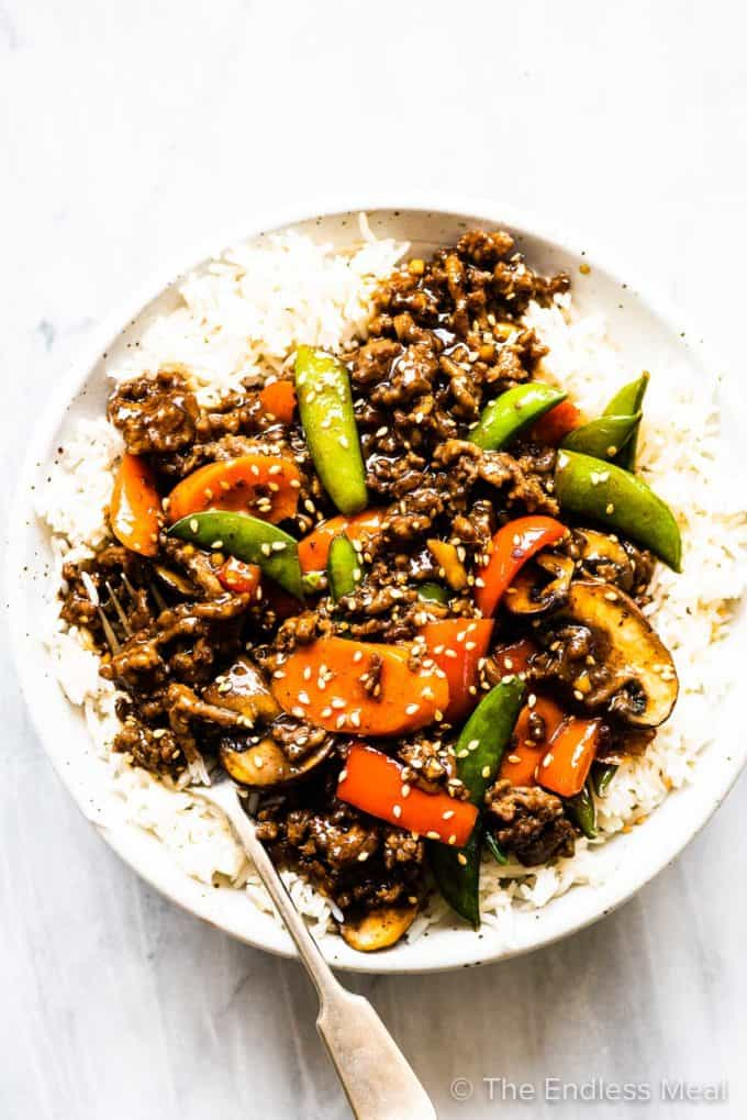 A plate of beef stir fry served over rice