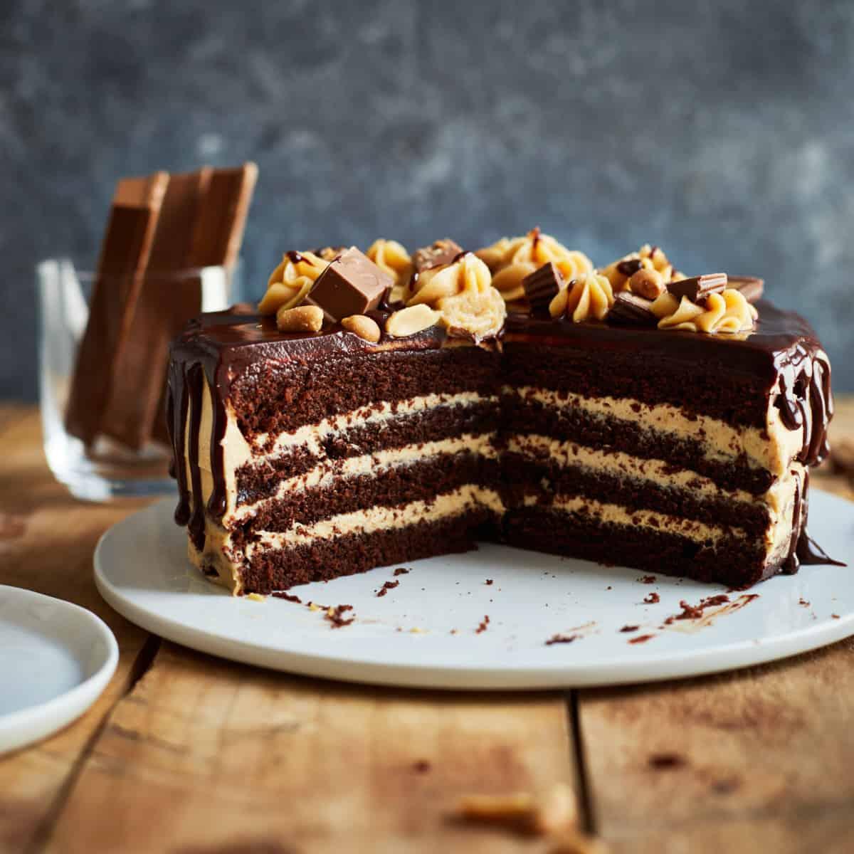 Cut peanut butter chocolate cake on a cake plate