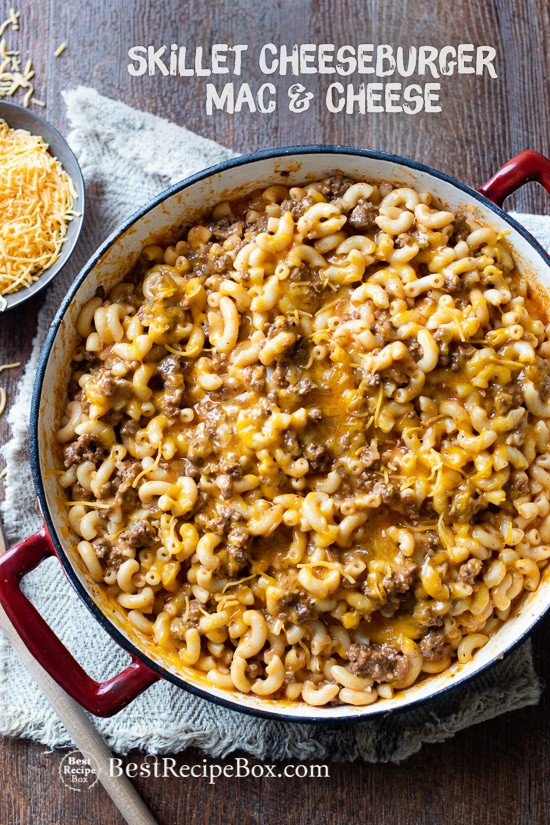 A pot full with noodles, cheese, and beef