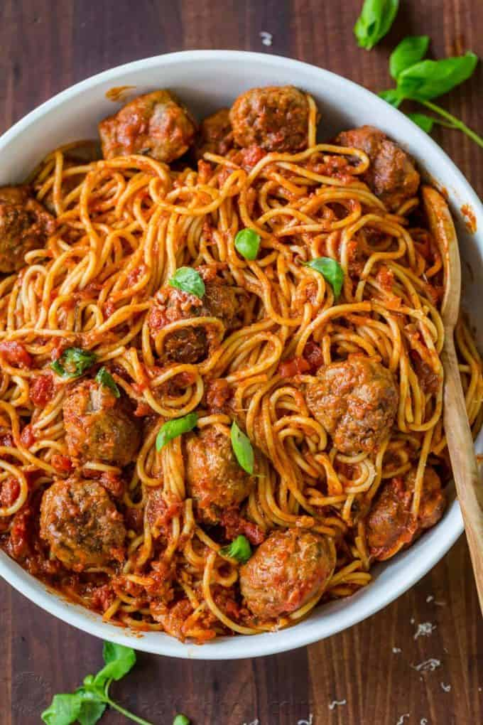 A large bowl filled with spaghetti and meatballs